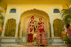 Elegant indian bride and groom's wedding outfit