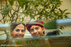 Lovely capture of indian bride and groom on their wedding car