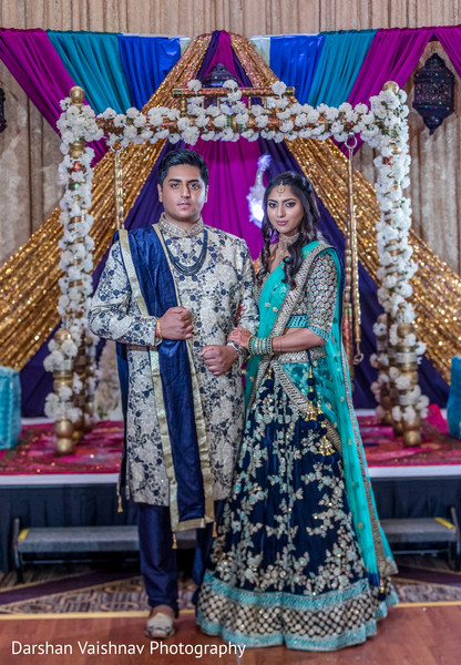 Lovely indian couple in their sangeet outfits