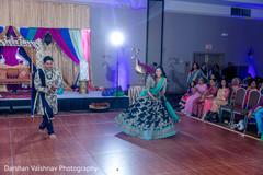 Indian bride and groom dancing during sangeet