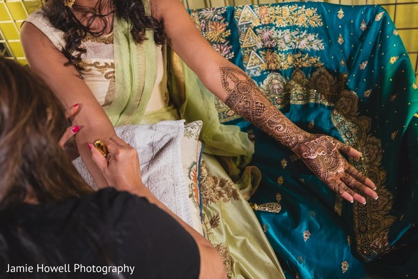 indian bride,indian pre-wedding celebration,indian mehndi party,henna art