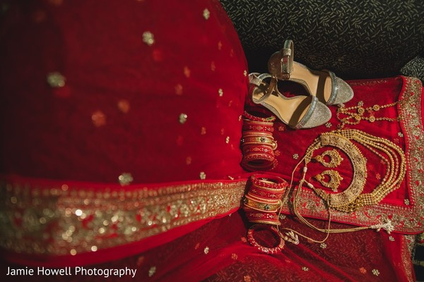 Marvelous Indian bridal red bangles, shoes, lehenga and golden jewelry.
