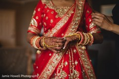 Dazzling Indian bride putting her ring on.