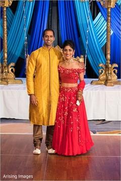 Joyful Indian bride on their sangeet outfits capture.
