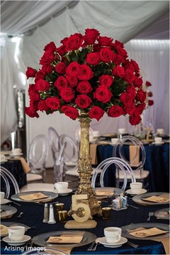 Marvelous Indian wedding reception red roses decoration.