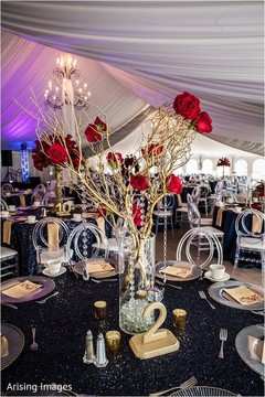 Spectacular Indian wedding reception table flower decor.
