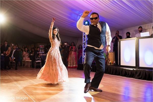 Maharani and parent doing a dance performance.