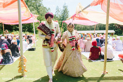 Sweet indian couple leaving wedding ceremony
