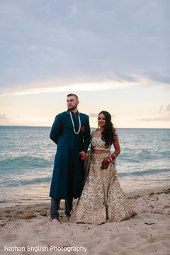 Lovely indian bride and groom by the beach photoshoot