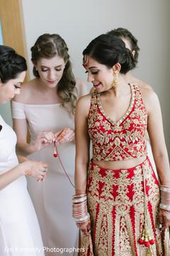 Bridal party helping maharani get ready