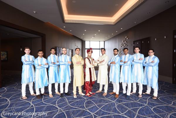 Elegant Indian groom and groomsmen posing for photo shoot.