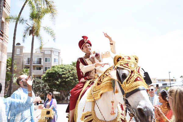 Magnificent Indian groom riding his baraat horse capture.
