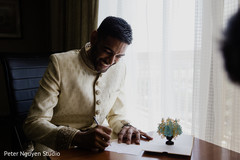 Fun capture of Indian groom writing a letter