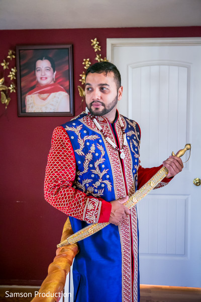 Elegant Indian groom poses with the Kirpan.