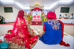 Tender moment between the Indian couple staring at the Mandap