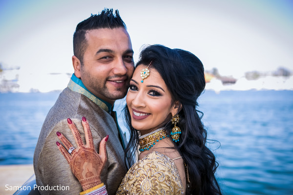 Wonderful landscape behind the happy Indian newlyweds