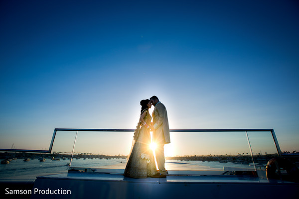 Mesmerizing shot of the Indian newlyweds as the sun sets behind them.