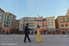 Romantic Indian bride and groom walk.