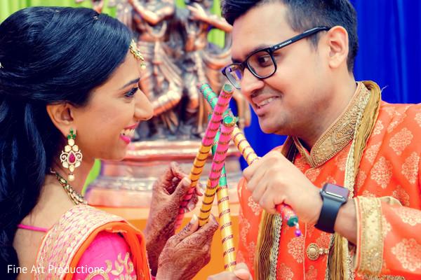 indian bride and groom,dandiya raas,sangeet fashion,sangeet