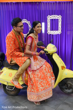 Lovely Indian couple on a  scooter capture.