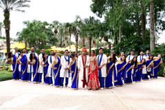 Magnificent Indian lovebirds portrait with bridesmaids and groomsmen.