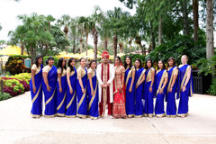 Dazzling Indian bride and groom with bridesmaids capture.
