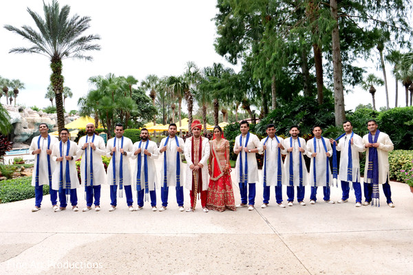 Charming Indian bride and groom with  groomsmen capture.