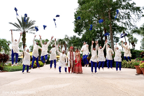 Indian bride and groom with groomsmen fun moment.