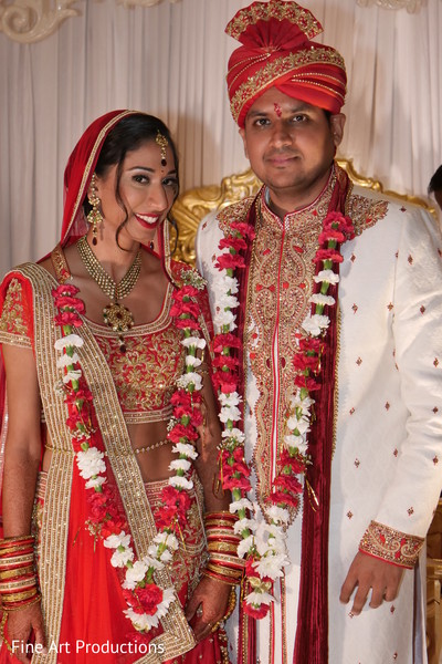 Margestic Indian couple on their ceremony outfits.