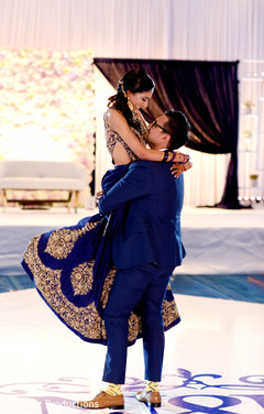 Indian bride and groom at their first dance capture.