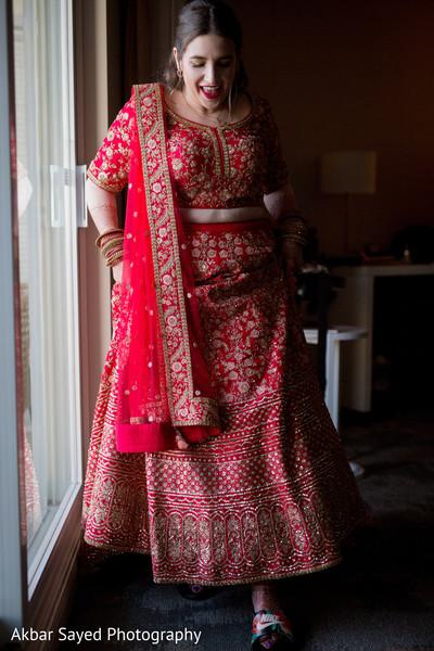 Indian bride getting ready wearing the sari.