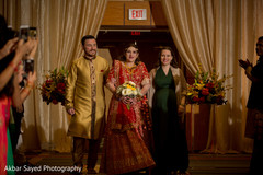 The Indian bride makes her entrance along with her family.