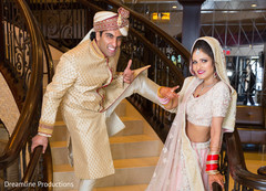 Indian bride and groom have a fun moment during the session