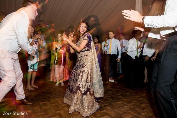 Stunning Indian bride on the reception dance floor.