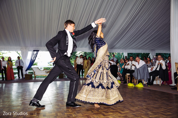 Indian bride and groom at their first reception dance.