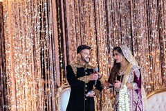 Groom hands the microphone to the maharani for a speech.