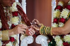 Indian couple during the wedding exchange rings ritual.