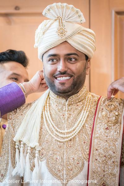 Elegant indian groom on his golden sherwani.