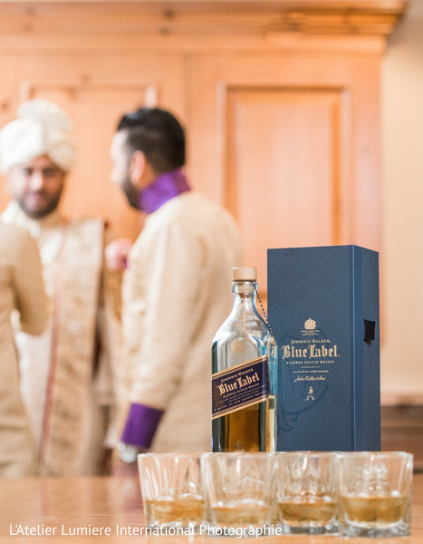 Indian groom with groomsmen ready for a toast.