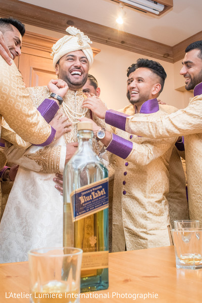 Indian groom celebrating before the wedding.