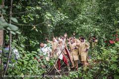 Joyful Indian groom on his baraat procession.