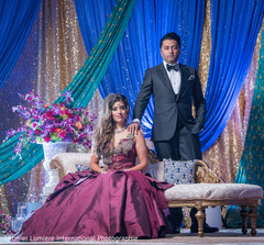 Glamorous Indian bride and groom on their wedding reception outfits.