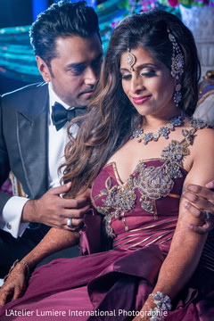 Romantic indian couple on their wedding reception outfits.