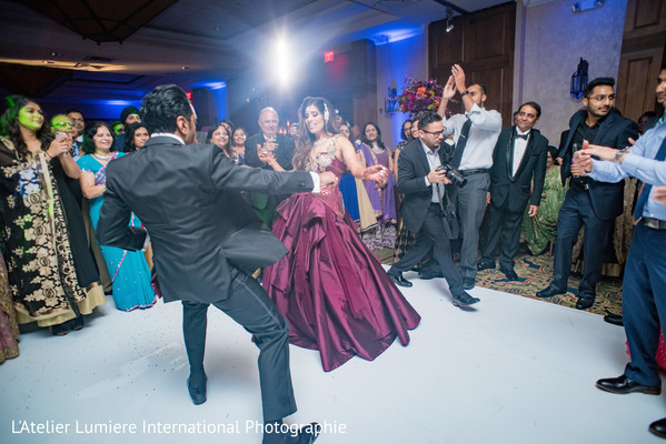 Upbeat Indian guest, bride and groom celebration.