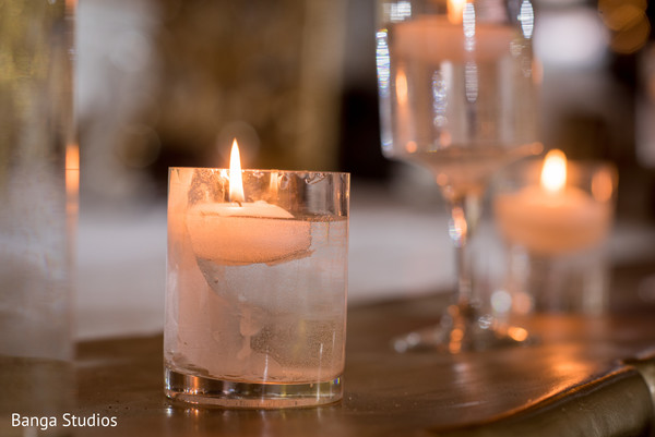 Indian wedding reception glass and candle decor.
