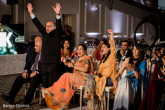 Cheerful guests at Indian wedding reception capture.
