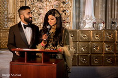 Indian bride and groom's reception speech moment capture.