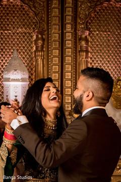 Joyful Indian couple dancing capture.