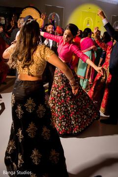 Joyful indian bridesmaids rocking the dance floor.