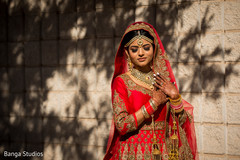 Enchanting Indian bride on her wedding ceremony outfit.